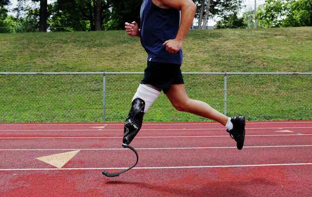 Matt Swartz, a New York State trooper, runs at the Knox Field track Friday July 27, 2012 in Johnstown, N.Y. Trooper Swartz lost his lower left leg in a car accident. (Dan Little/Special to the Times Union) Photo: Dan Little / Dan Little