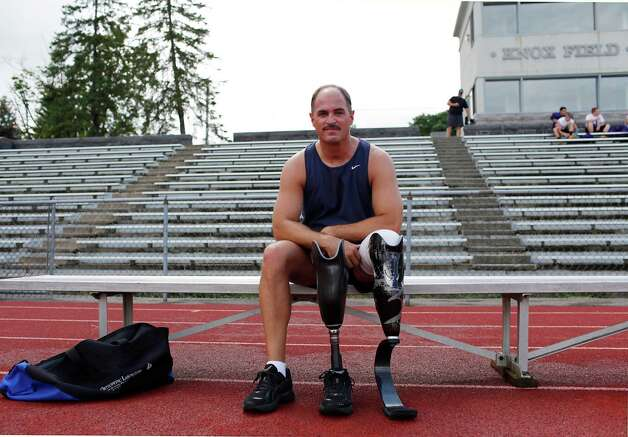 Matt Swartz, a New York State trooper, poses following a track workout at the Knox Field track Friday July 27, 2012 in Johnstown, N.Y. Trooper Swartz lost his lower left leg in a car accident. (Dan Little/Special to the Times Union) Photo: Dan Little / Dan Little