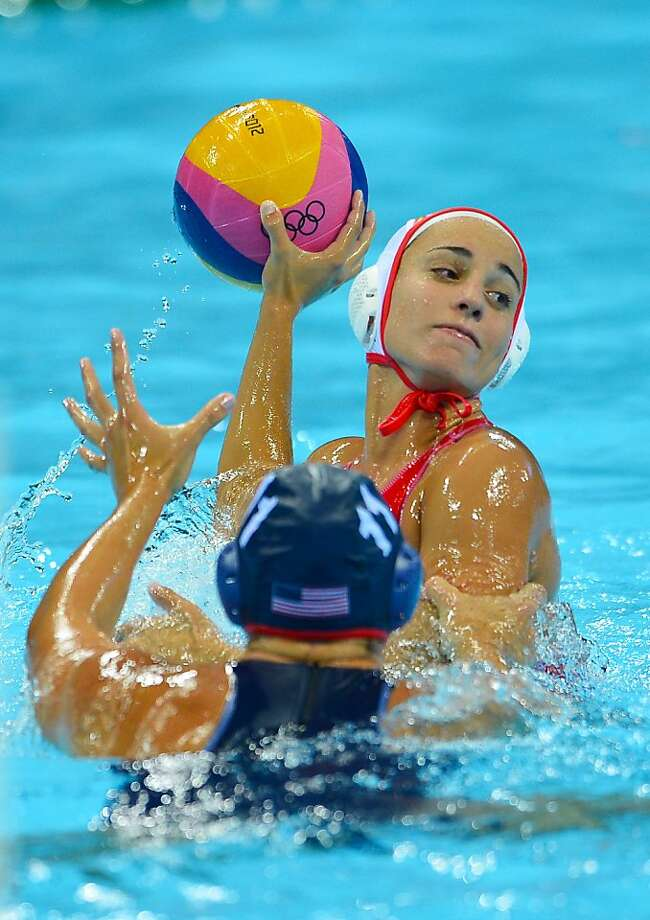Spain's Anni Espar Llaquet (R) is challenged by US' Annika Dries in the women's water polo preliminary round groupe A match between Spain and USA at the Water Polo Arena on August 1, 2012 in London during the London 2012 Olympic Games. AFP PHOTO / MIGUEL MEDINAMIGUEL MEDINA/AFP/GettyImages Photo: Miguel Medina, AFP/Getty Images