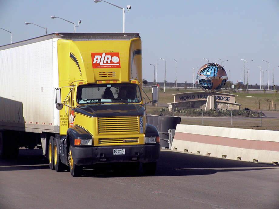 A Mexican trailer crosses the World Trade Bridge into Laredo, Texas from Nuevo Laredo, Tamaulipas, Mexico, Wednesday, Dec. 26, 2001. Mexican trucks who pass an inspection will be allowed to travel on U.S. highways after Jan. 1, 2002 as part of the North American Free Trade Agreement (NAFTA). (Photo by Ricardo Santos)  HOUCHRON CAPTION (12/29/2001):  A rig crosses the World Trade Bridge into Laredo. Photo: Ricardo Santos / Freelance