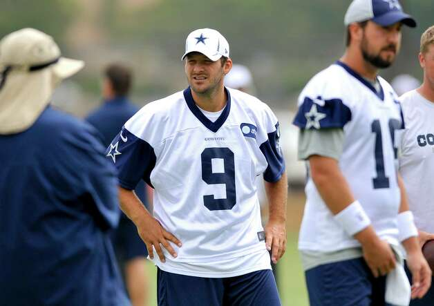 Dallas Cowboys quarterback Tony Romo looks on as coaches go over plays with plays during NFL training camp, Wednesday, Aug. 1, 2012, in Oxnard, Calif. (AP Photo/Gus Ruelas) Photo: Gus Ruelas, Associated Press / FR157633 AP