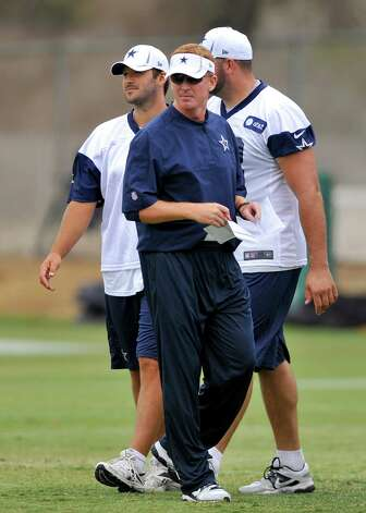Dallas Cowboys head coach Jason Garrett looks on as his offense executes plays during NFL training camp, Wednesday, Aug. 1, 2012, in Oxnard, Calif. (AP Photo/Gus Ruelas) Photo: Gus Ruelas, Associated Press / FR157633 AP