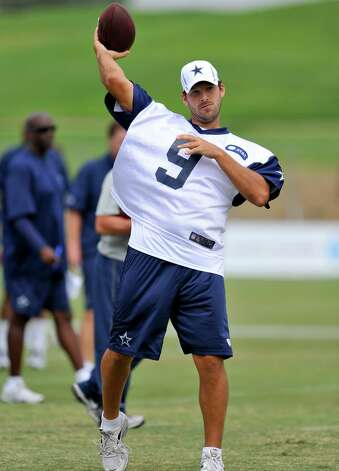 Dallas Cowboys quarterback Tony Romo makes a pass as the offense runs plays during NFL training camp, Wednesday, Aug. 1, 2012, in Oxnard, Calif. (AP Photo/Gus Ruelas) Photo: Gus Ruelas, Associated Press / FR157633 AP