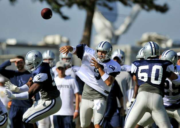 Dallas Cowboys quarterback Tony Romo (9) throws a pass while executing a play during NFL football training camp, Wednesday, Aug. 1, 2012, in Oxnard, Calif. (AP Photo/Gus Ruelas) Photo: Gus Ruelas, Associated Press / FR157633 AP