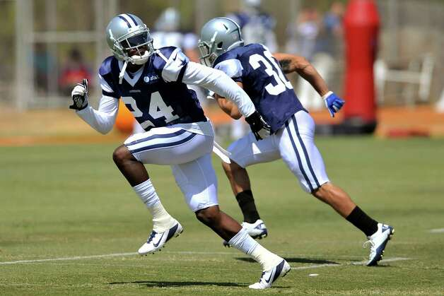 Dallas Cowboys cornerback Morris Claiborne (24) and defensive back Isaac Madison (30) run drills during NFL football training camp, Wednesday, Aug. 1, 2012, in Oxnard, Calif. (AP Photo/Gus Ruelas) Photo: Gus Ruelas, Associated Press / FR157633 AP