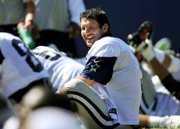 Dallas Cowboys quarterback Tony Romo jokes with teammates as the stretch during NFL football training camp, Wednesday, Aug. 1, 2012, in Oxnard, Calif. (AP Photo/Gus Ruelas) Photo: Gus Ruelas, Associated Press / FR157633 AP