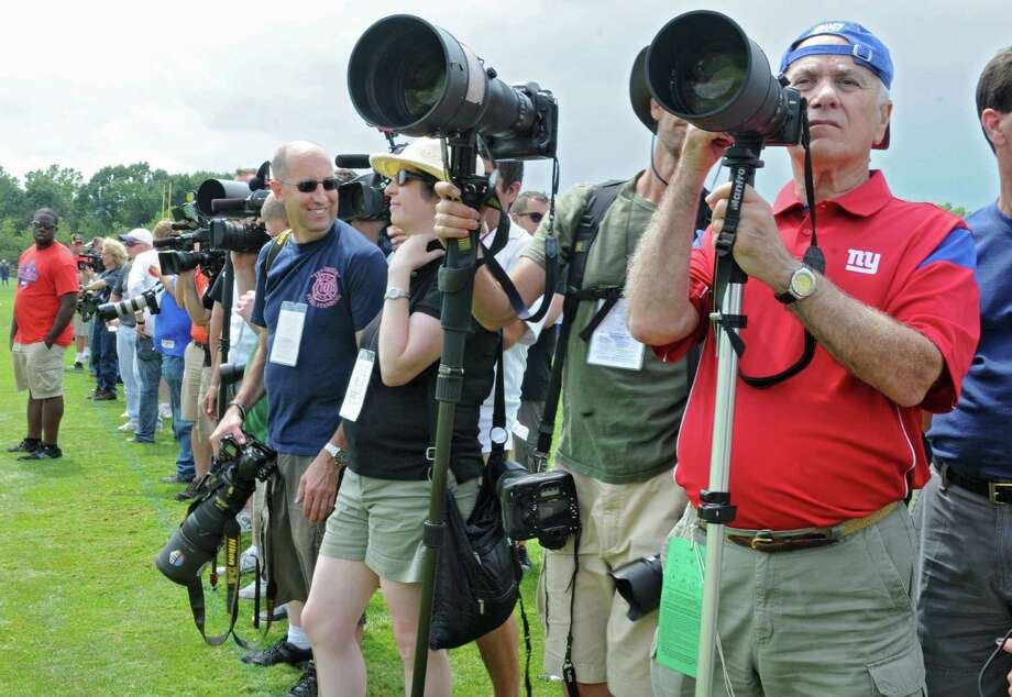 Photographers stand on the side line during New York Giants Training Camp Wednesday, August 1, 2012 in Albany, N.Y. (Lori Van Buren / Times Union) Photo: Lori Van Buren
