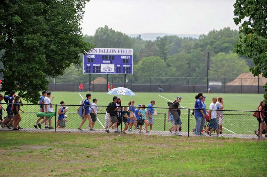 Fans start to leave at the first signs of rain drops, thunder and lightening during the New York Giants Training Camp Wednesday, August 1, 2012 in Albany, N.Y. (Lori Van Buren / Times Union) Photo: Lori Van Buren