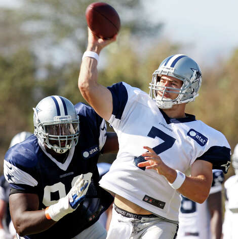 Dallas Cowboys quarterback Stephen McGee passes as Dallas Cowboys defensive end Clifton Geathers moves in on the play during practice at the 2012 training camp held Wednesday Aug 1, 2012 in Oxnard, CA. Photo: Edward A. Ornelas, San Antonio Express-News / © 2012 San Antonio Express-News