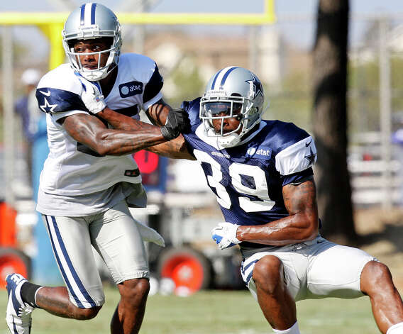 Dallas Cowboys wide receiver Kevin Ogletree (left) and Dallas Cowboys cornerback Brandon Carr run a play during 2012 training camp held Wednesday Aug 1, 2012 in Oxnard, CA. Photo: Edward A. Ornelas, San Antonio Express-News / © 2012 San Antonio Express-News