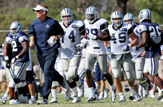 Dallas Cowboys head coach Jason Garrett (left) runs up field with the team during 2012 training camp held Wednesday Aug 1, 2012 in Oxnard, CA. Photo: Edward A. Ornelas, San Antonio Express-News / © 2012 San Antonio Express-News