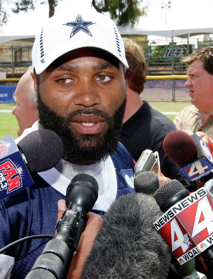 Dallas Cowboys linebacker Anthony Spencer answers questions from the media after practice during 2012 training camp held Wednesday Aug 1, 2012 in Oxnard, CA. Photo: Edward A. Ornelas, San Antonio Express-News / © 2012 San Antonio Express-News