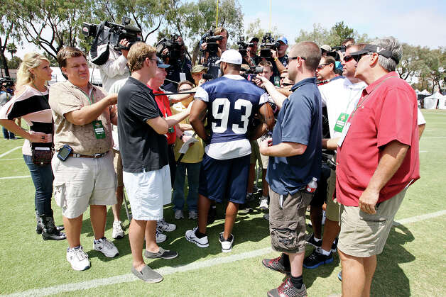 Dallas Cowboys linebacker Anthony Spencer (center) answers questions from the media after practice during 2012 training camp held Wednesday Aug 1, 2012 in Oxnard, CA. Photo: Edward A. Ornelas, San Antonio Express-News / © 2012 San Antonio Express-News