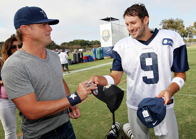Actor George Eads (left) and Dallas Cowboys quarterback Tony Romo exchange autographed hats after practice during 2012 training camp held Wednesday Aug 1, 2012 in Oxnard, CA. Photo: Edward A. Ornelas, San Antonio Express-News / © 2012 San Antonio Express-News