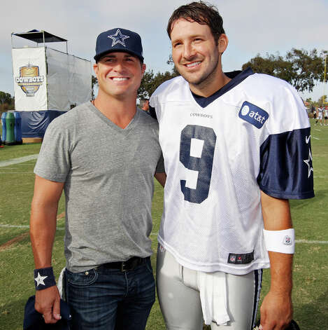 Actor George Eads (left) and Dallas Cowboys quarterback Tony Romo pose for photos after practice during the 2012 training camp held Wednesday Aug 1, 2012 in Oxnard, CA. Photo: Edward A. Ornelas, San Antonio Express-News / © 2012 San Antonio Express-News