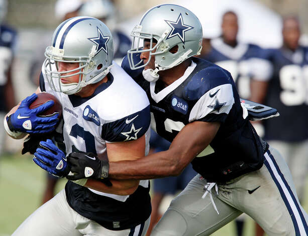 Dallas Cowboys tight end Jason Witten looks for room around Dallas Cowboys safety Barry Church during 2012 training camp held Wednesday Aug 1, 2012 in Oxnard, CA. Photo: Edward A. Ornelas, San Antonio Express-News / © 2012 San Antonio Express-News