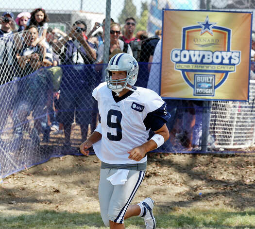 Dallas Cowboys quarterback Tony Romo runs onto the field during 2012 training camp held Wednesday Aug 1, 2012 in Oxnard, CA. Photo: Edward A. Ornelas, San Antonio Express-News / © 2012 San Antonio Express-News