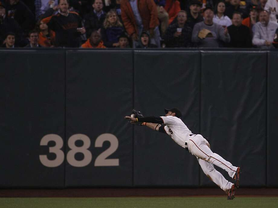 Giant's center field Gregor Blanco catches a third out during the bottom of the fourth inning at AT&T park in San Francisco, Calif., during a game against New York Mets on Wednesday, August 1, 2012. Photo: Liz Hafalia, The Chronicle