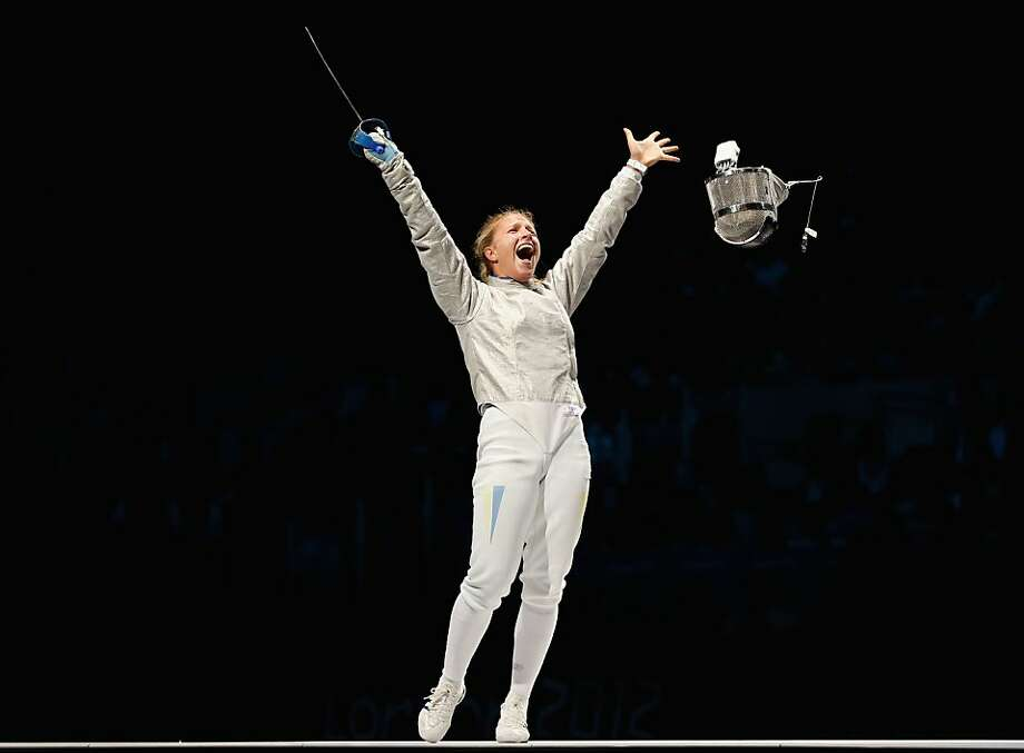 Olga Kharlan of Ukraine celebrates victory in the Women's Sabre Individual Fencing Bronze Medal match against Mariel Zagunis of the United States on Day 5 of the London 2012 Olympic Games at ExCeL  on August 1, 2012 in London, England. Photo: Hannah Johnston, Getty Images