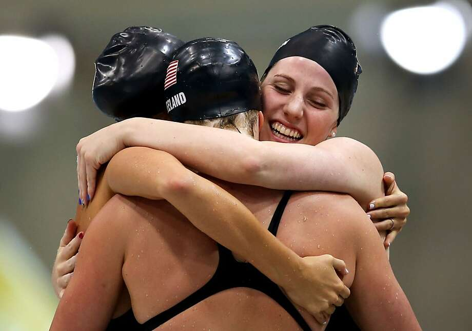 LONDON, ENGLAND - AUGUST 01:  Shannon Vreeland (L), Missy Franklin (R), Allison Schmitt (C) and Dana Vollmer (obscured) of the United States celebrate after they won the Final of the Women's 4x200m Freestyle Relay on Day 5 of the London 2012 Olympic Games at the Aquatics Centre on August 1, 2012 in London, England.  (Photo by Clive Rose/Getty Images) ***BESTPIX*** Photo: Clive Rose, Getty Images