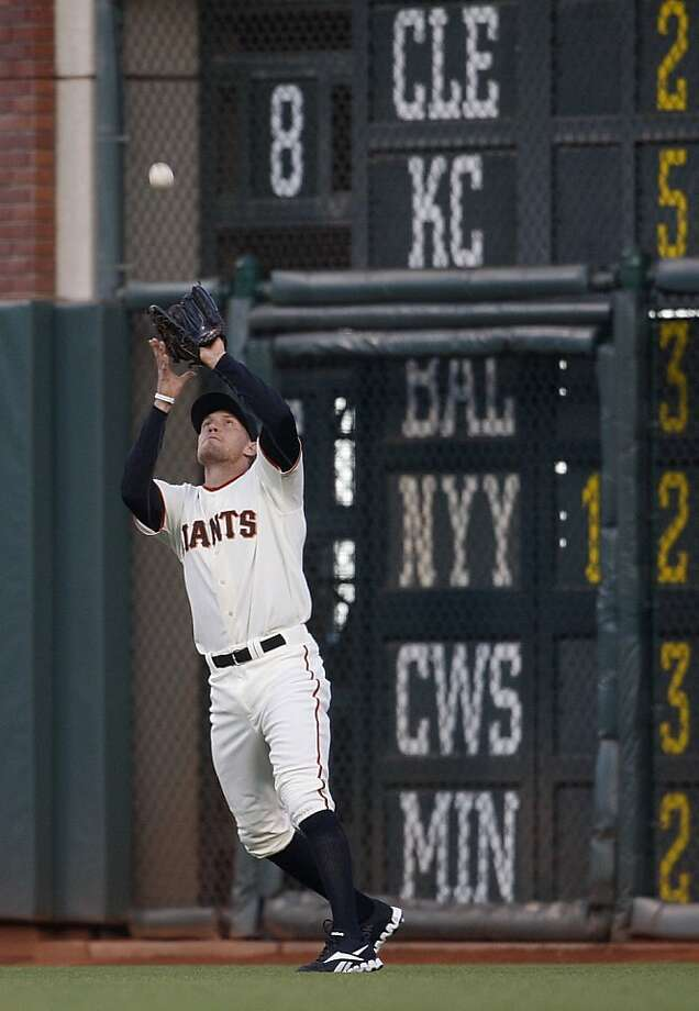 Hunter Pence makes a catch during the first  inning of Wednesday's game against the Mets at AT&T Park. Photo: Liz Hafalia, The Chronicle