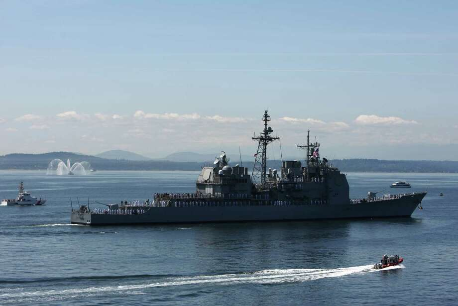 The guided-missile cruiser USS Bunker Hill (CG 52) passes the Seattle waterfront during the annual Seafair Fleet Week Parade of Ships on Wednesday, August 1, 2012 on Elliott Bay. Photo: JOSHUA TRUJILLO / SEATTLEPI.COM