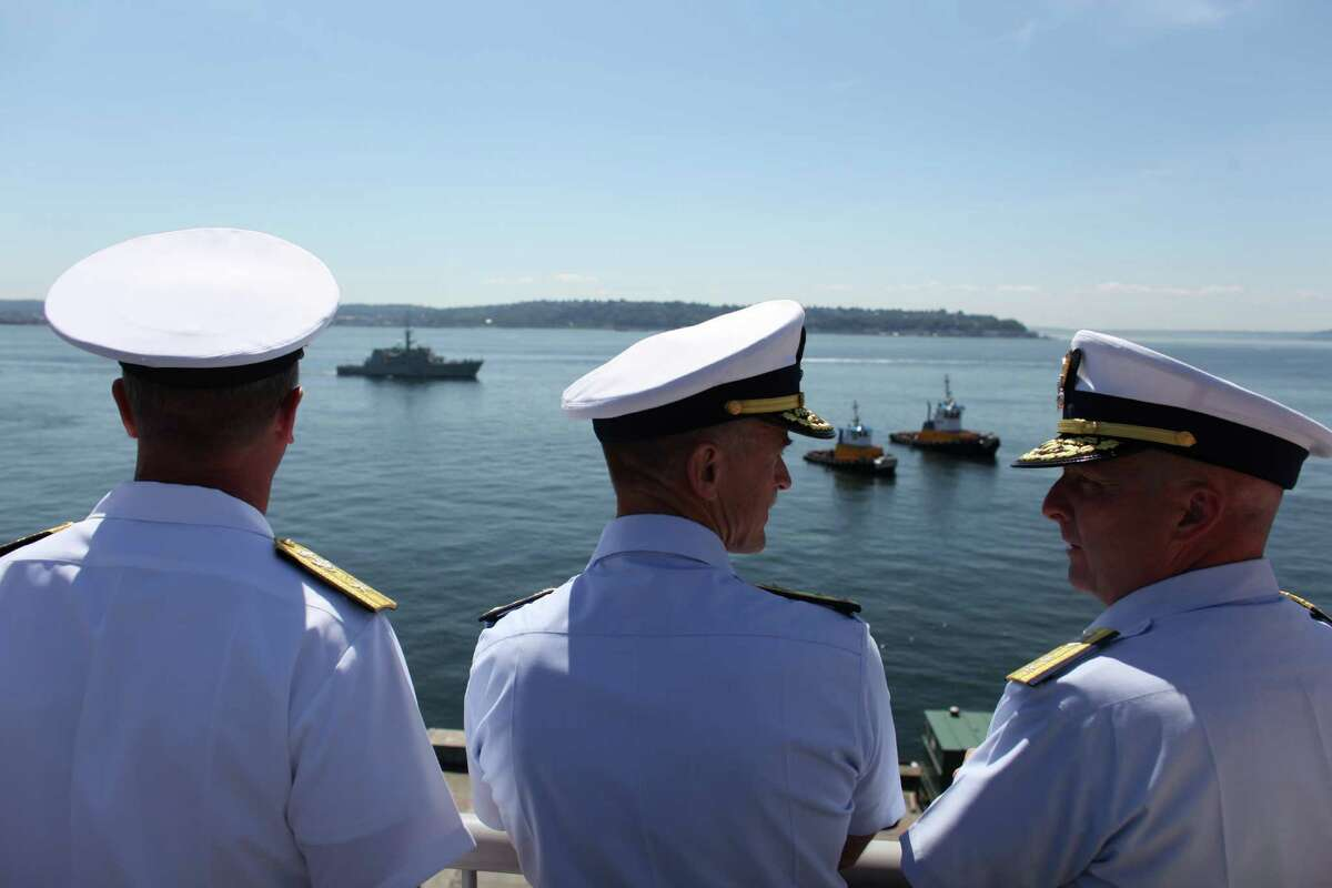 U.S. Navy Rear Admiral Thomas Shannon, Vice Admiral Paul Zukunft, and Rear Adrmiral Keith Taylor watch ships pass during the annual Seafair Fleet Week Parade of Ships on Wednesday, August 1, 2012 on Elliott Bay.