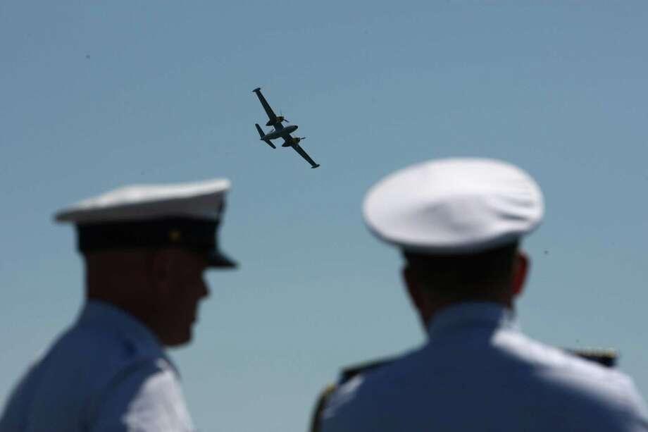 A U.S. Navy aircraft fles overhead during the annual Seafair Fleet Week Parade of Ships on Wednesday, August 1, 2012 on Elliott Bay. Photo: JOSHUA TRUJILLO / SEATTLEPI.COM