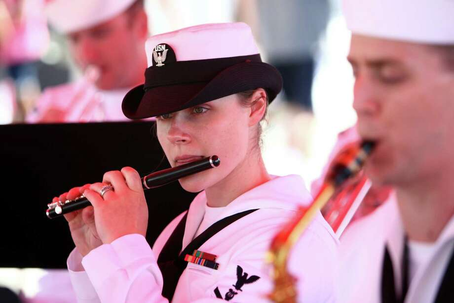 A member of the U.S. Navy band performst during the annual Seafair Fleet Week Parade of Ships on Wednesday, August 1, 2012 on Elliott Bay. Photo: JOSHUA TRUJILLO / SEATTLEPI.COM