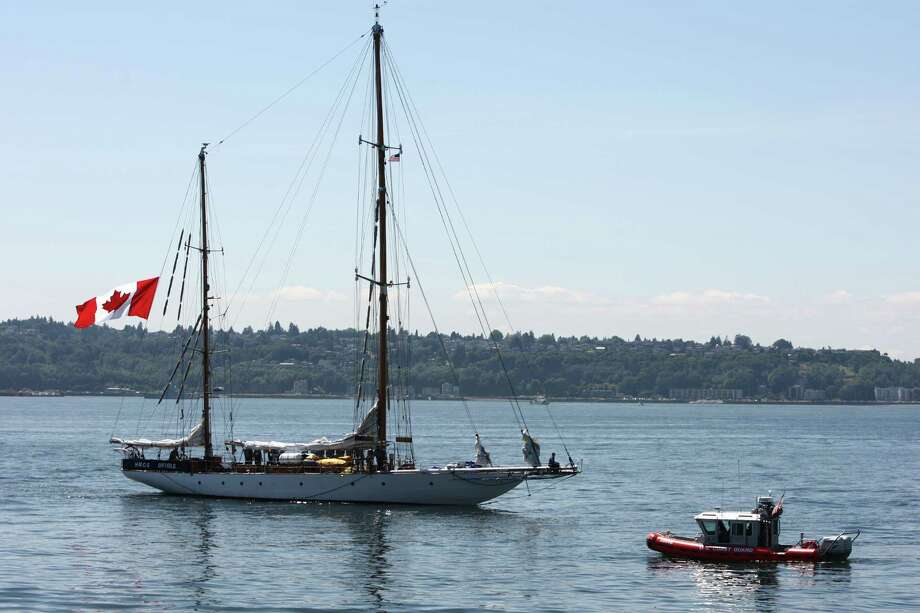The HMCS Oriole passes the review stand during the annual Seafair Fleet Week Parade of Ships on Wednesday, August 1, 2012 on Elliott Bay. Photo: JOSHUA TRUJILLO / SEATTLEPI.COM