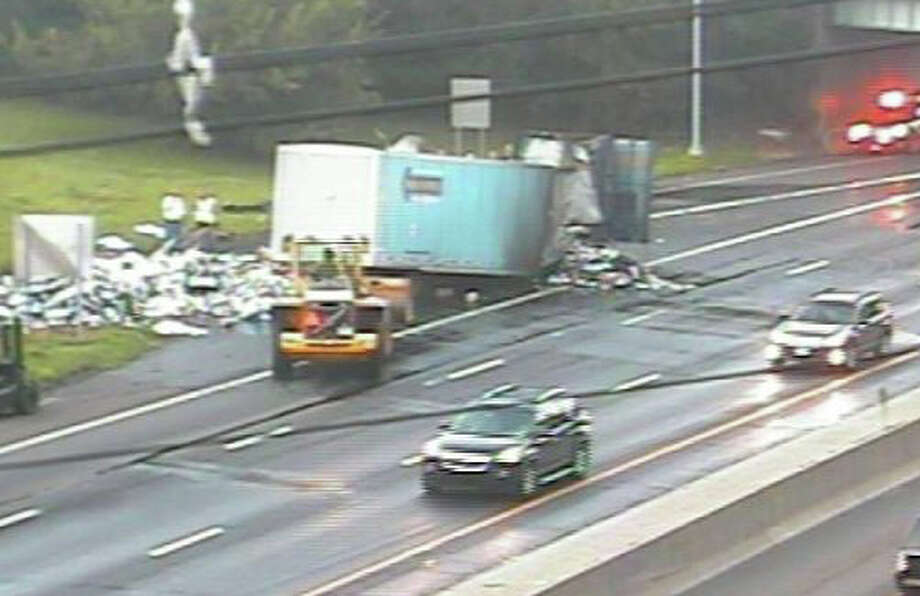 Traffic was at virtual standstill near northbound Exit 23 on Interstate 95 in Fairfield after a tractor-trailer truck crashed and caught fire. Here, debris is cleared from the crash scene. Photo: CT DOT Traffic Camera / Fairfield Citizen contributed