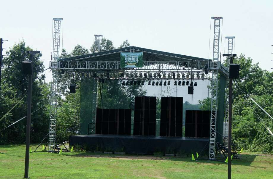 """The """"temporary"""" stage used by the Levitt Pavilion for the Performing Arts would be replaced by a new $6.7 million complex, for which the Board of Finance on Wednesday approved a $1.1 million allocation. Photo: Paul Schott / Westport News"""