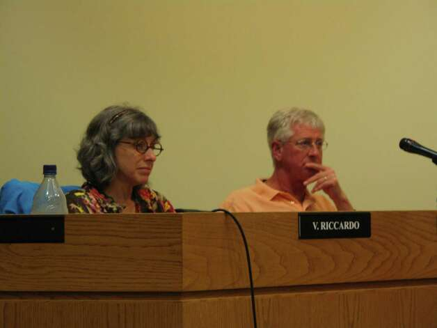 Commissioners Vickie Riccardo and Keith Kearney listen to Nina Miller of Choose to Reuse in Darien explain some of the misconceptions of the plastic bag ban ordinance that is being discussed at the Environmental Protection Commission meeting on Wednesday, Aug. 1, 2012. Darien, Conn. Photo: Thomas Michael