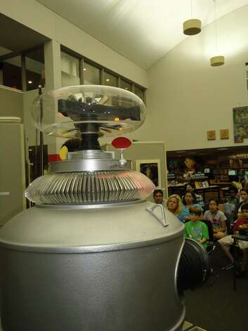 "The ""Lost in Space"" robot replica spoke to the crowd Wednewsday night at the Westport Public Library, but didn't say its signature line from the popular 1960s TV show: ""Danger, Will Robinson, danger!"" Photo: Meg Barone / Westport News freelance"
