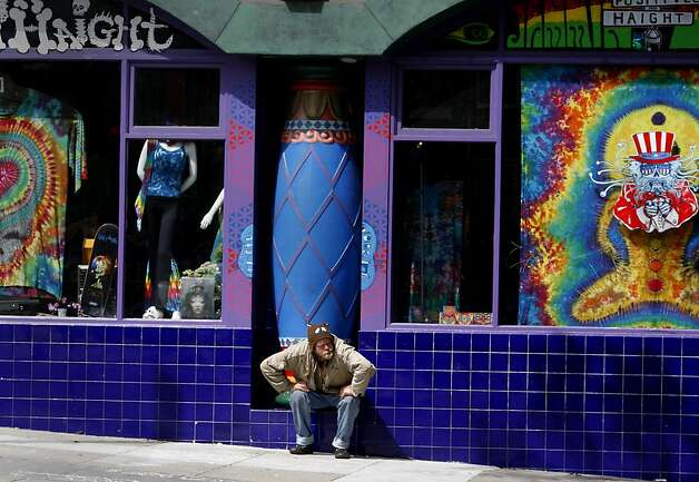 Justin O'Brien finds a place to sit on Masonic near Haight Street.  He has over 30 sit/lie citations. In the first year of enforcement, the San Francisco Police department handed out dozens of sit/lie citations, mostly to longtime homeless people who have problems with alcohol. Photo: Brant Ward, The Chronicle