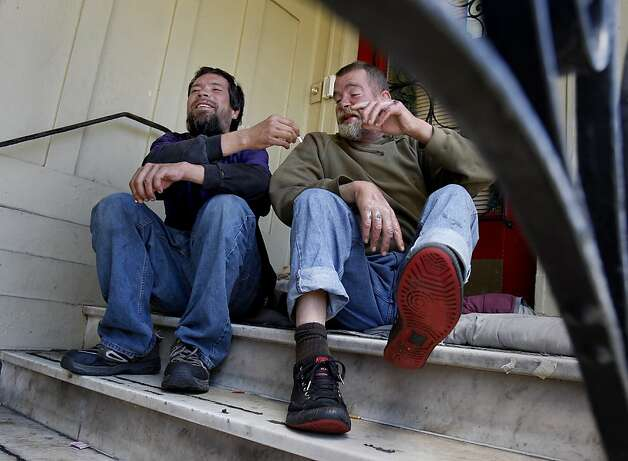 Roland Dequina (left) and Justin O'Brien (right) hang out on the steps of a residence on Masonic Street.  The two men have over fifty sit/lie citations between them. In the first year of enforcement, the San Francisco Police department handed out dozens of sit/lie citations, mostly to longtime homeless people who have problems with alcohol. Photo: Brant Ward, The Chronicle