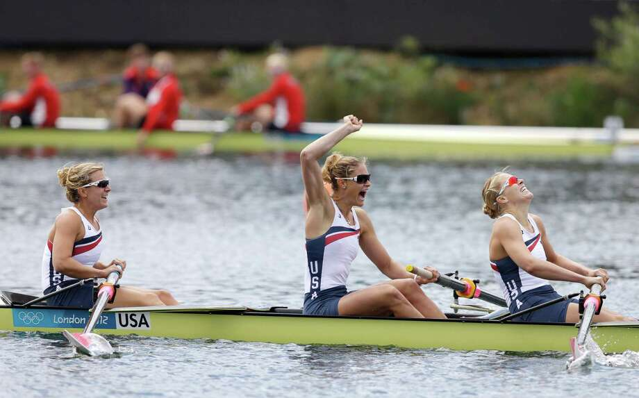 U.S. rowers, Eleanor Logan, Meghan Musnicki, and Taylor Ritzel of the women's rowing eight team, celebrate after winning the gold medal in Eton Dorney, near Windsor, England, at the 2012 Summer Olympics, Thursday, Aug. 2, 2012. (AP Photo/Chris Carlson) Photo: Chris Carlson, ASSOCIATED PRESS / AP2012