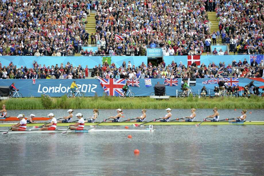 The US team crosses the finish ahead of the Canada and the Netherlands' team in the women's eight final of the rowing event during the London 2012 Olympic Games, at Eton Dorney Rowing Centre in Eton, west of London, on August 2, 2012.    AFP PHOTO / ERIC FEFERBERG Photo: Getty