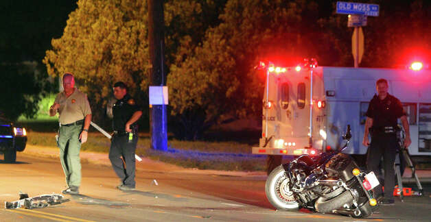 San Antonio police work at the scene of a fatal motorcycle crash early Thursday August 2, 2012 at Nacogdoches and Old Moss. According to San Antonio police sergeant J.R. Fiste, a 50-year-old man driving a motorcycle north on Nacogdoches between 4:30 and 5:00 a.m. collided with a sport utility vehicle driven by a female who initially fled the scene and was later tracked down by police.  The victim's identity has not been released and the female driver who fled the scene is being questioned by police. John Davenport/©San antonio Express-News Photo: John Davenport/© San Antonio Express-News, San Antonio Express-News / John Davenport/©San Antonio Express-News