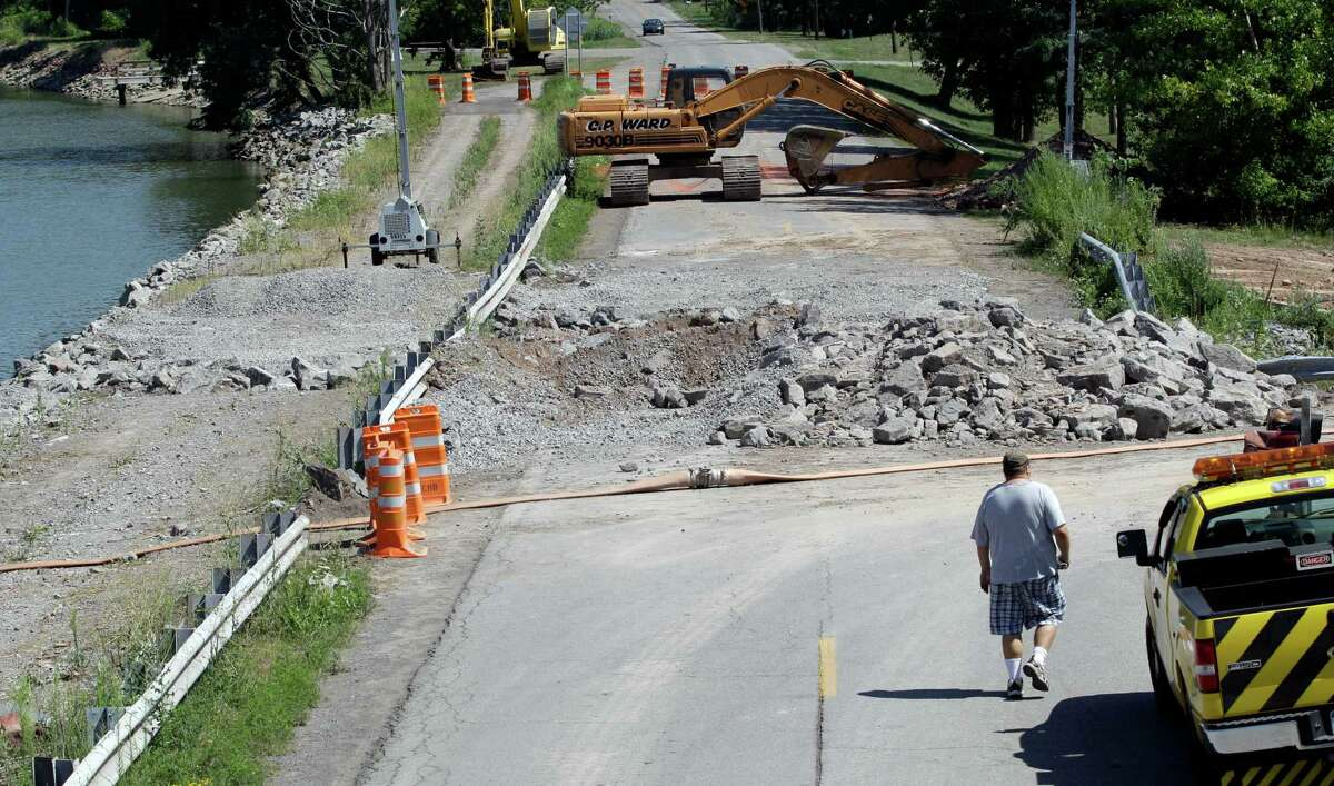 The site of a breach in a wall of the Erie Canal is shown in Albion, N.Y., Wednesday, Aug. 1, 2012. A scenic 25-mile stretch of the Erie Canal in western New York is temporarily off limits to boaters following a partial collapse of the embankment in the Orleans County village of Albion, authorities said Wednesday.