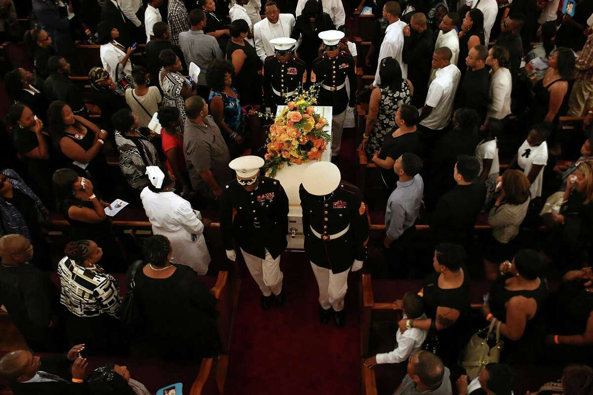 NEW YORK, NY - AUGUST 01: Harlem Youth Marines carry out the coffin at the conclusion of the funeral for 4-year-old Lloyd Morgan who was killed by a stray bullet in the Bronx last week on August 1, 2012 in New York City. The Reverend Al Sharpton delivered the eulogy for the funeral. The child was killed near a basketball tournament that erupted into a gunfight last Sunday night. Three people are charged in connection with the shooting and face murder charges.