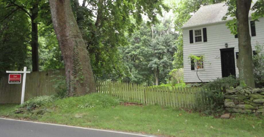 The historic Henry Munroe house on Cross Highway, one of two Westport properties listed on the Connecticut Freedom Trail, is offered for sale by its owner, who earlier this year had sought to demolish the structure. Photo: Meg Barone / Westport News freelance