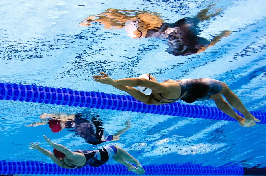 France's Laure Manaudou (R) competes in the women's 200m backstroke heats swimming event at the London 2012 Olympic Games on August 2, 2012 in London. (FRANCOIS XAVIER MARIT / AFP/Getty Images)