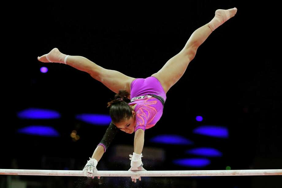LONDON, ENGLAND - AUGUST 02:  Jessica Lopez of Venezuela competes on the uneven bars in the Artistic Gymnastics Women's Individual All-Around final on Day 6 of the London 2012 Olympic Games at North Greenwich Arena on August 2, 2012 in London, England. Photo: Ronald Martinez, Getty Images / 2012 Getty Images