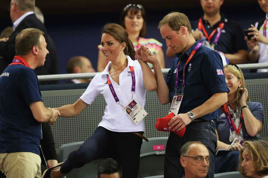 LONDON, ENGLAND - AUGUST 02:  Catherine, Duchess of Cambridge is helped to her seat by Prince William, Duke of Cambridge and Andy Hunt, Chef de Mission for Great Britain as they watch the track cycling on Day 6 of the London 2012 Olympic Games at Velodrome on August 2, 2012 in London, England. Photo: Bryn Lennon, Getty Images / 2012 Getty Images