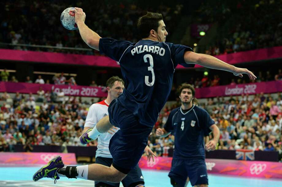Argentina's Federico Pizarro jumps to shoot during the men's preliminary Group A handball match Great Britain vs Argentina for the London 2012 Olympics Games on August 2, 2012 at the Copper Box hall in London. AFP PHOTO/ JAVIER SORIANOJAVIER SORIANO/AFP/GettyImages Photo: JAVIER SORIANO, AFP/Getty Images / AFP