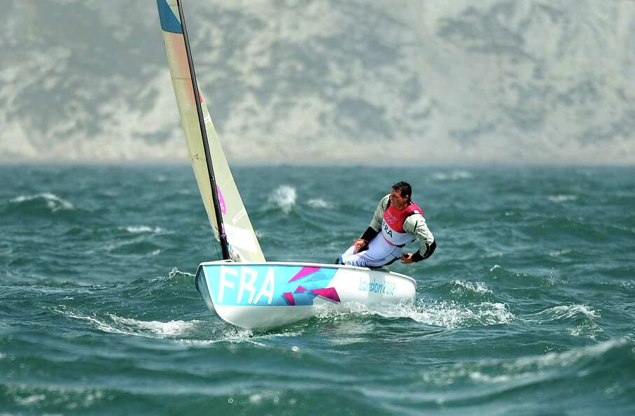 France's Jonathan Lobert sails through the rough conditions in the Finn sailing class at the London