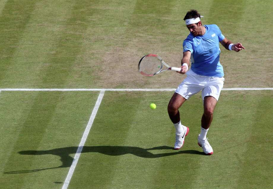 LONDON, ENGLAND - AUGUST 02:  Juan Martin Del Potro of Argentina returns the ball to Kei Nishikori of Japan during the Quarterfinal of Men's Singles Tennis on Day 6 of the London 2012 Olympic Games at Wimbledon on August 2, 2012 in London, England. Photo: Clive Brunskill, Getty Images / 2012 Getty Images