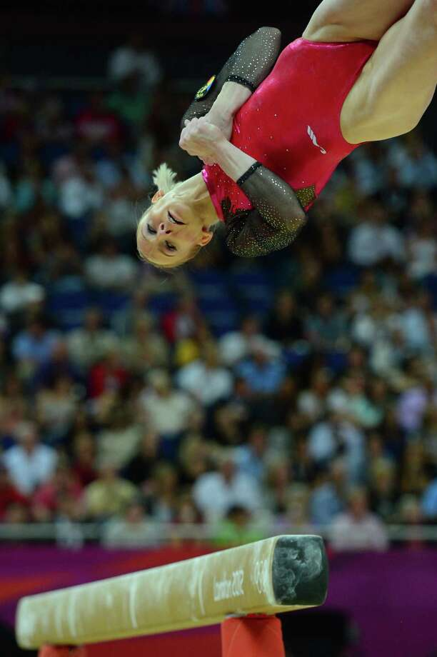 Romania's gymnast Sandra Raluca Izbasa performs on the beam during the artistic gymnastics women's individual all-around final at the 02 North Greenwich Arena in London on August 2, 2012 during the London 2012 Olympic Games. AFP PHOTO / EMMANUEL DUNANDEMMANUEL DUNAND/AFP/GettyImages Photo: EMMANUEL DUNAND, AFP/Getty Images / AFP