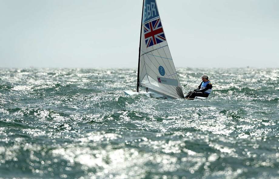 Britain's Ben Ainslie sails through the rough conditions in the Finn sailing class at the London 2012 Olympic Games, in Weymouth on August 2, 2012.  AFP PHOTO/William WESTWILLIAM WEST/AFP/GettyImages Photo: WILLIAM WEST, AFP/Getty Images / AFP